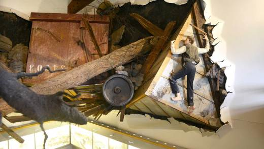 An exhibit depicting 16-year old Victor Heiser hanging onto a barn roof during the Johnstown Flood at the Johnstown Flood National Memorial. (Robin Rombach/Post-Gazette)