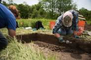 Eden Vantries, left, and Cheryl Frankum from the Indiana University of Pennsylvania Department of Anthropology excavate in the Fort Necessity National Battlefield in Farmington on June 22, 2016. (Haley Nelson/Post-Gazette)