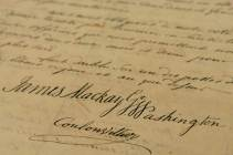 A detail from the Fort Necessity Surrender Document, signed on July 3, 1754, by Lt. Col. George Washington, Capt. James Mackay and French commander Louis Coulon de Villiers. The surrender sparked the French and Indian War. (Steve Mellon/Post-Gazette)
