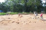 Archaeologists begin to excavate post molds identifying a structure that was part of an 800-year-old Native American fishing village on the New Jersey side of the Delaware Water Gap National Recreation Area. The park announced the discovery in 2004. (National Park Service, DEWA Archives)
