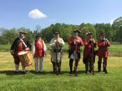 Re-enactors pose before demonstrating their muskets for visitors at Fort Necessity National Battlefield near Farmington in Fayette County. (Bob Batz Jr./Pittsburgh Post-Gazette)