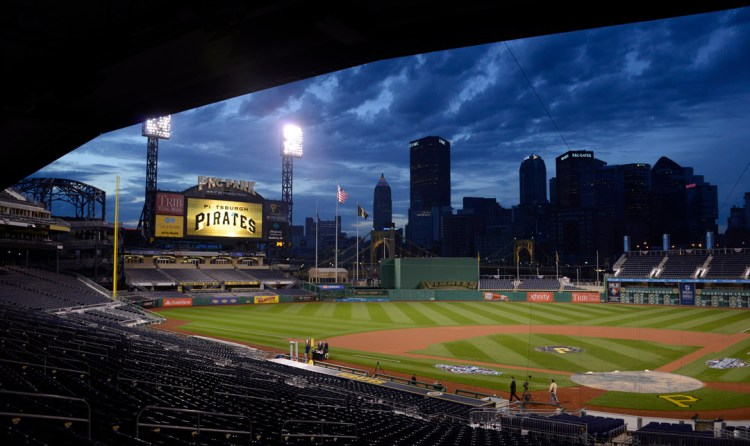 Clouds roll over  PNC Park  as daylight  for the Pirates Home Opener (Darrell Sapp/Post-Gazette).