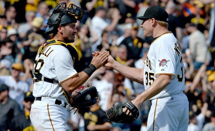 Pirates catcher Francisco Cervelli congratulates Mark Melancon after closing out the Tigers. (Matt Freed/Post-Gazette)