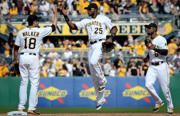 Pirates' Neil Walker, Gregory Polanco and Starling Marte celebrate their team's win. (Matt Freed/Post-Gazette)