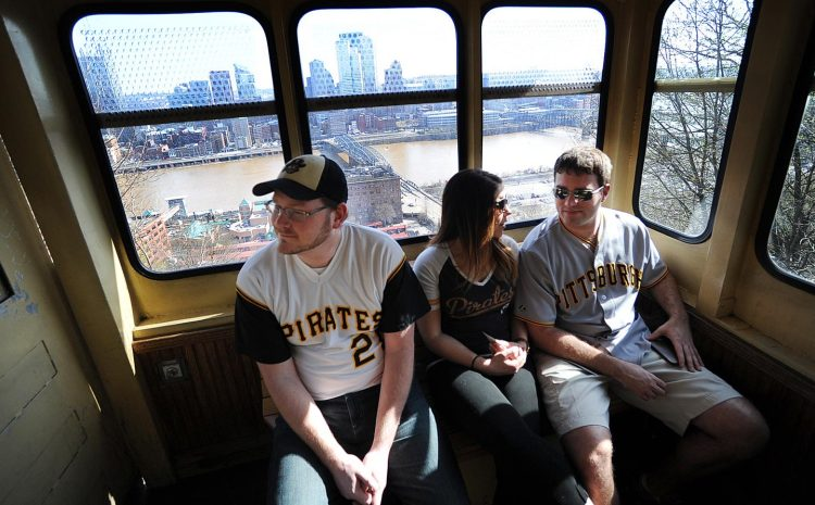 Lawson Hammond left,  Jessica Passinita and Greg Krayer take the Mon Incline to Carson Street before heading to PNC Park. (Nate Guidry/Post-Gazette)