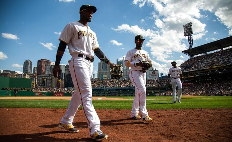 Starling Marte, Andrew McCutchen and Gregory Polanco walk off the field between innings. (Andrew Rush/Post-Gazette)