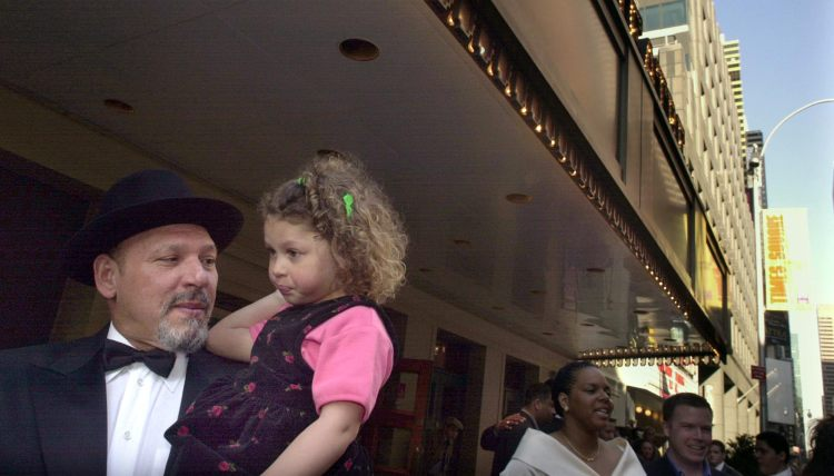"At the 2001 New York City  premiere of ""King Hedley II"",  playwright August Wilson who holds his daughter Azula,3, in front of the Virginia Theatre.  (Bill Wade/Post-Gazette)"