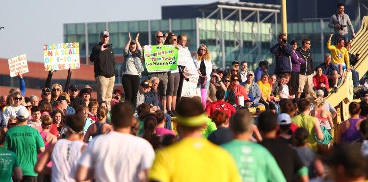 Crowd cheers runners as they cross the Rachel Carson Bridge. (Andrew Rush/Post-Gazette)