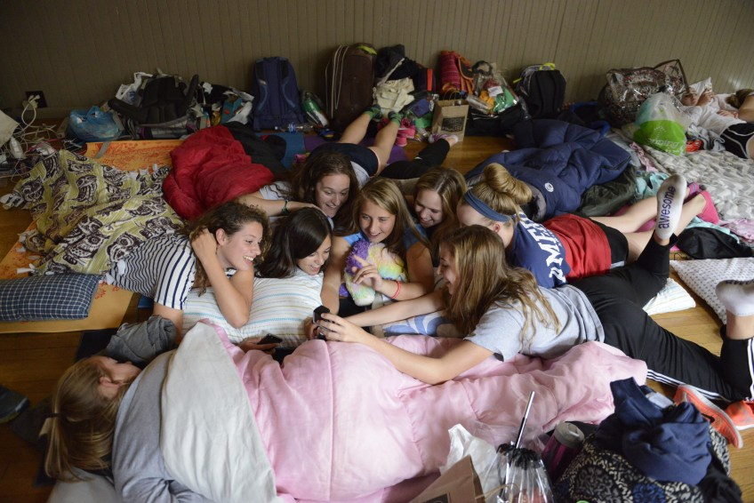 Oakland Catholic High School students take a moment to record video for a live blog on their pilgrimage to Philadelphia on Friday. The girls are sleeping at the First Unitarian Church in Center City near all the papal events over the weekend.