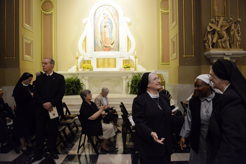 Nuns and priests wait for Mass to begin at the Cathedral Basilica of Saints Peter and Paul on Saturday.