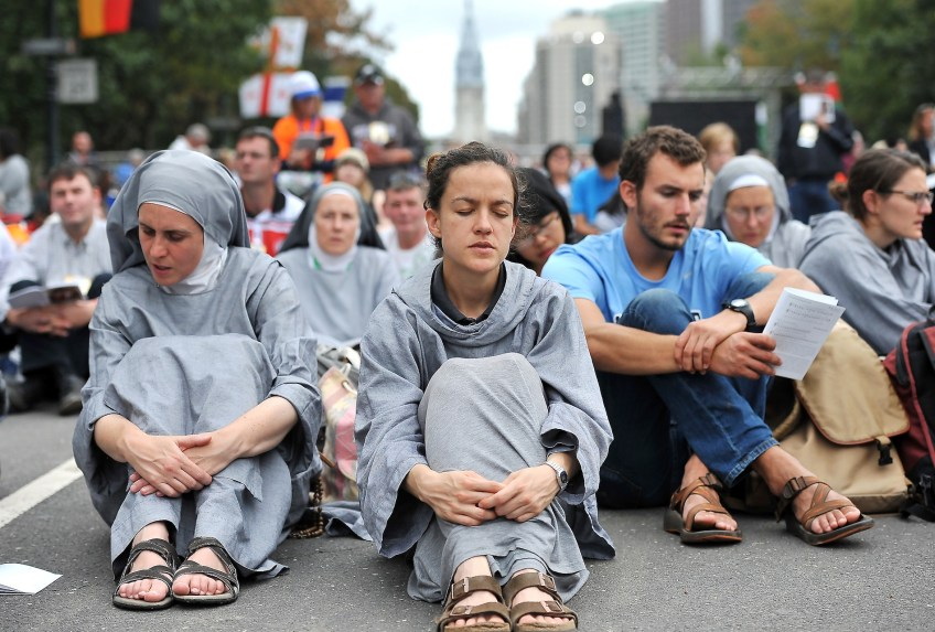 Novice Hope Lesnau from the Apostolic Sisters of St. John in Princeville, Ill., says it was powerful to hear the Pope speak his own language, as the pontiff celebrated Mass  along the Benjamin Franklin Parkway in Philadelphia on Sunday, Sept. 27. Ms. Lesnau said the Pope's message of healing the brokenness, especially in families, was important. (Rebecca Droke/Post-Gazette)