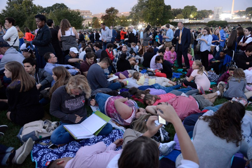 Catholic University of America students stake out seats high on the West Front Lawn hours before Pope Francis addresses Congress during his visit to Washington, D.C. on Thursday.