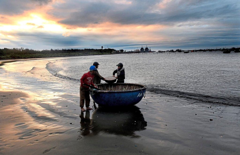Heavy winds force fishermen to the shore early Tuesday morning, Jan 30, 2018 in Da Nang, Vietnam. (Nate Guidry/Post-Gazette)