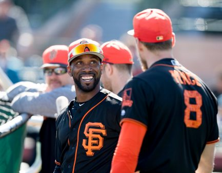 Andrew McCutchen shares a moment with outfielder Hunter Pence. (Steph Chambers/Post-Gazette)