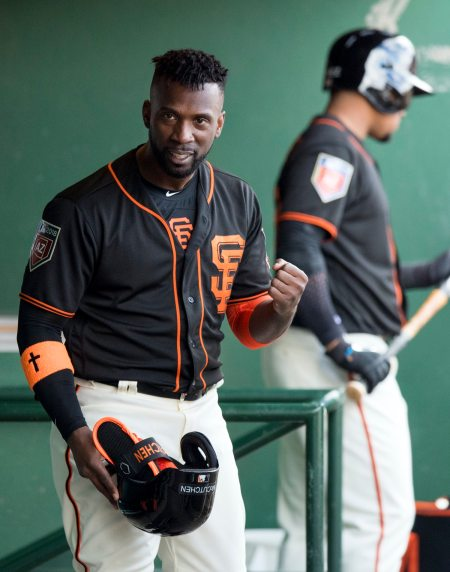 Andrew McCutchen pumps his first after the Giants scored a run in his first spring training game with his new team. (Steph Chambers/Post-Gazette)