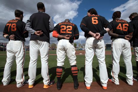 Andrew McCutchen stands for the national anthem alongside his new teammates. (Steph Chambers/Post-Gazette)