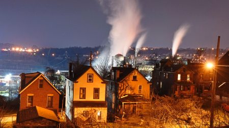 The U.S. Steel's Edgar Thompson Work, in Braddock, looms behind houses, Thursday April 12, 2018 in this view from North Braddock, Pa. (Darrell Sapp/Post-Gazette)