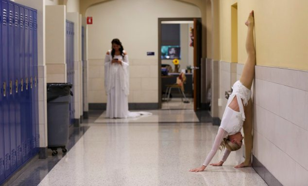 Joelle Pahanish and Micaela Ricco warm up before the talent portion of the pageant. Pahanish sang an opera selection, and Ricco performed an acrobatic routine. (Jessie Wardarski/Post-Gazette)