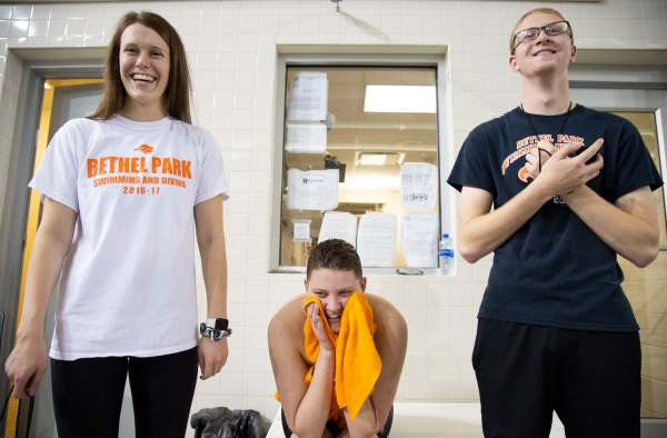 """Friends Krista Wycinsky, 19, of California, PA, left, Colby Love, 18, of Bethel Park, center, and Steven Sell, 20, of Bethel Park, right, laugh as they stand together on the pool deck after Love finished a relay during Bethel Park Swim Team's senior night against Canon MacMillan Thursday, Feb. 7, 2019, at Bethel Park High School in Bethel Park. """"Krista is just judgement free all of the time,"""" says Colby of Wycinsky who has been one of Love's biggest supporters and friends throughout his depression, anxiety and gender reassignment."""