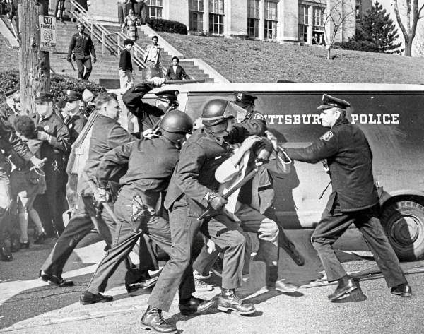 """""""Police wrestle Perry High student into submission following racial outbreak"""" at the school, reads the caption on this photo from April 7, 1970. Dozens of students were detained. (Robert Pavuchak/Pittsburgh Press)"""