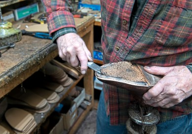 Bill Wells, 81, owner of Charles the Cobbler, work on customer shoes Tuesday March 12, 2019, in his shop in Peters Township. (Nate Guidry/Post-Gazette)