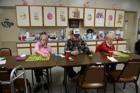 """If that mill gets back to full production, that means more money coming back down,"" says Fred Pernick, 83, director of the Mingo Junction Senior Center, who hopes the city's funds available to donate to the senior center will increase, as well. He plays bingo, which raises money for the center, with Barbara Jackson, left, 87, and Millie Huggins, 77."