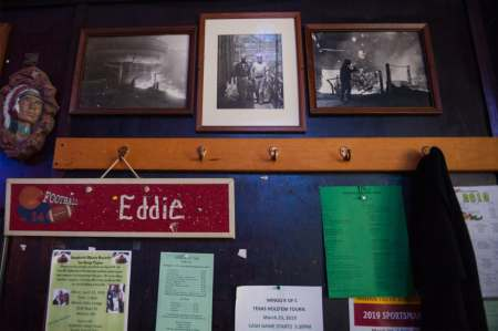Historical photos from the blast furnace and other scenes from the town's steel mill hang amongst flyers and other memorabilia on the walls of Spuds Parkview Inn.