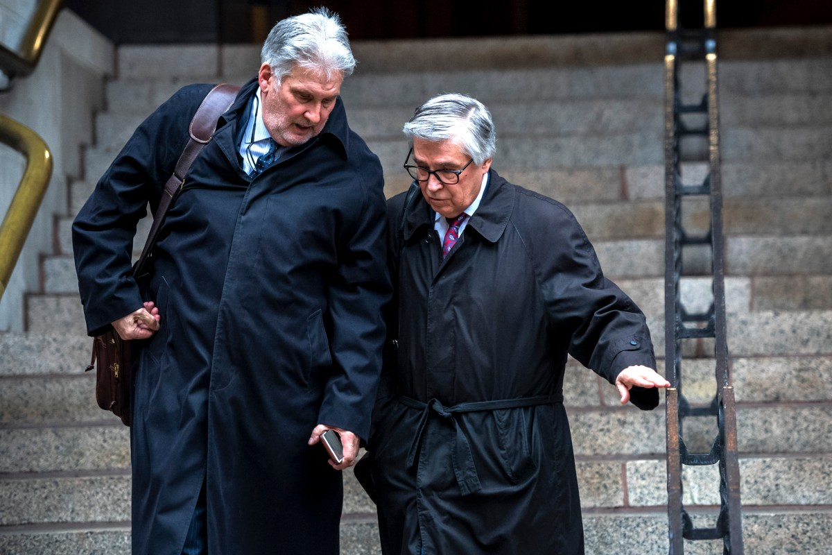 Investigator Jim Smith, left, and attorney Patrick Thomassey, right, who are both Former East Pittsburgh police Officer Michael Rosfeld's defense team leave the courthouse after the conclusion of the third day of  Michael Rosfeld's homicide trial, Thursday, March 21, 2019, at the Allegheny County Courthouse, Downtown. (Michael M. Santiago/Post-Gazette)