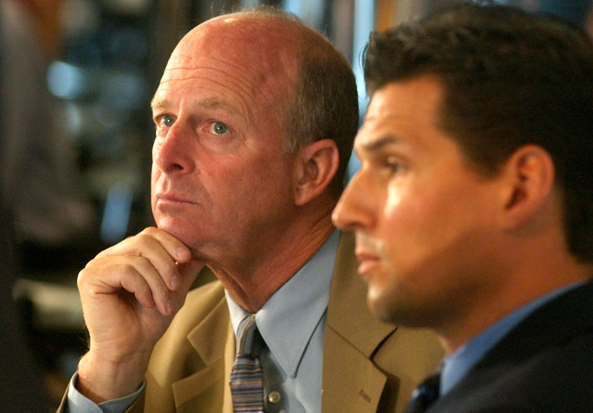 Penguins GM Craig Patrick listens to Mario Lemieux at the podium with coach Ed Olczyk on July 31, 2003, in the Igloo Club at Mellon Arena. Lemieux announced  he would return for a 16th season with the Penguins.         (Darrell Sapp/Post-Gazette)