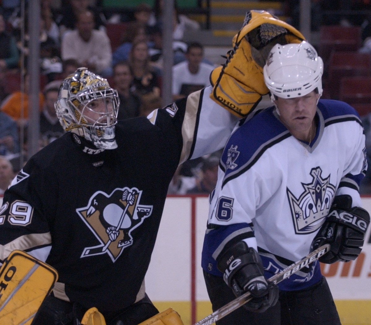 "After his debut as a rookie, Marc-Andre Fleury received a subtle nod from the visiting team, including Trent Klatt as seen here. ""The Kings came off the bench, and all of them to a man skated over to Fleury and tapped him on the pads,"" Mike Lange said. ""It was an unbelievable moment."""