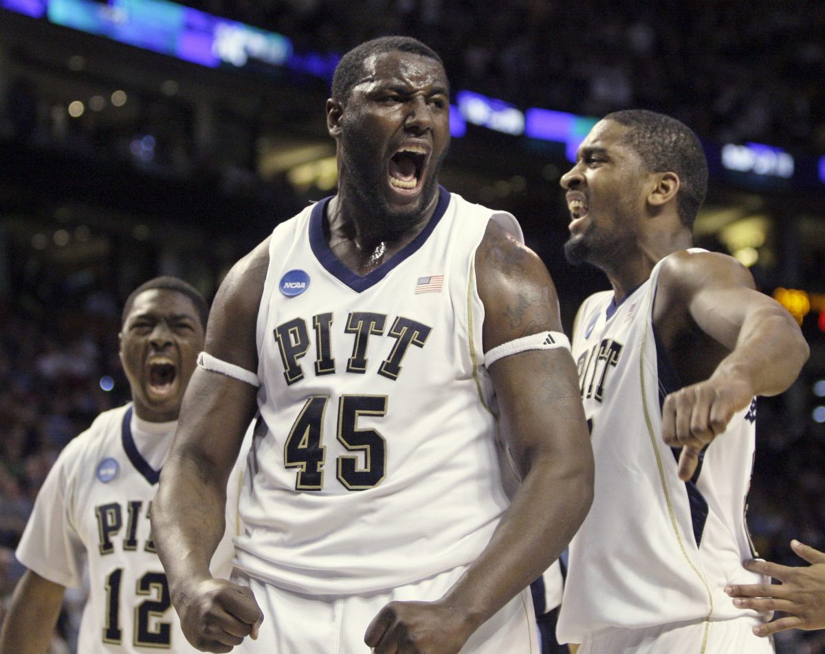DeJuan Blair celebrates alongside Ashton Gibbs, left, and Brad Wanamaker, right, during the first half against Villanova in the Elite Eight in Boston on Saturday, March 28, 2009.  (Elise Amendola/Associated Press)