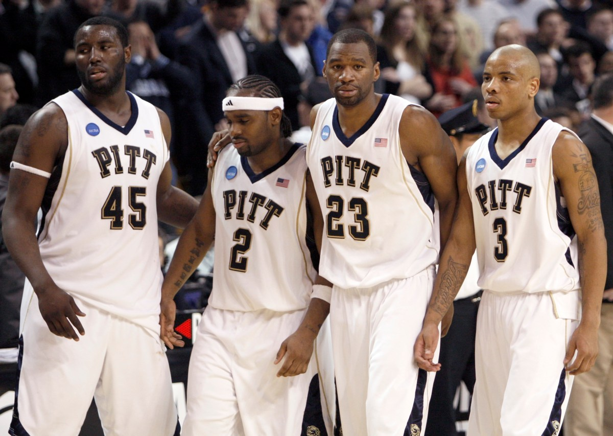 From left, Pitt's DeJuan Blair, Levance Fields, Sam Young and Jermaine Dixon leave the court after losing 78-76 to Villanova in a men's NCAA tournament regional championship college basketball game in  Boston, Saturday, March 28, 2009. (Winslow Townson/Associated Press)