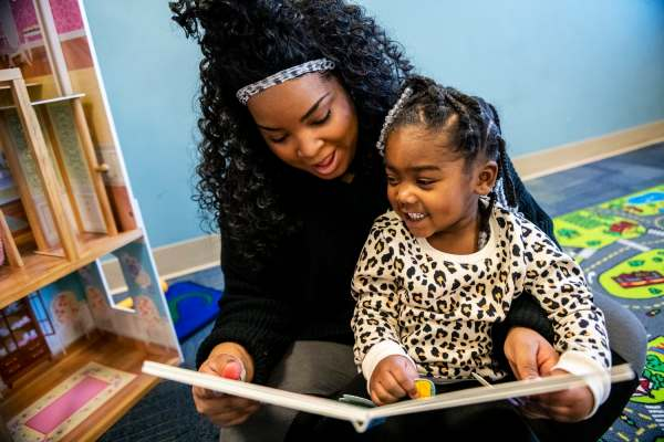 Jasamin Johnson, 25, reads to her daughter Taylor Norfleet, 3, while spending time in the playroom, Friday, January 25, 2019, at Family Scholar House in Louisville, Ky. Ms. Johnson works full-time while studying human resource management online at Indiana Institute of Technology. By completing community engagement sessions and classes while pregnant, she was able to move into Family Scholar House three weeks after Taylor was born.