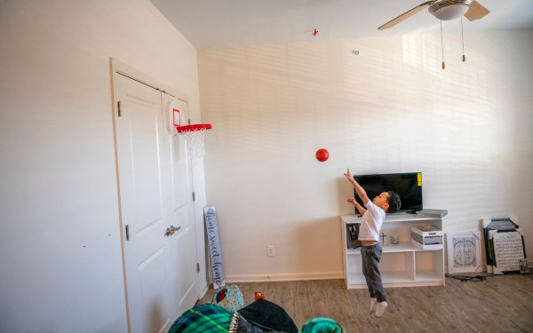 Tevin Webster, 4, shoots hoops while waiting for his mother Destiny Clark, 22, to prepare breakfast, Friday, Jan. 25, 2019, at the Family Scholar House campus in Louisville, Ky.