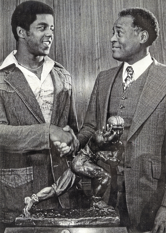 Herb Douglas Jr , right, congratulates Tony Dorsett, winner
