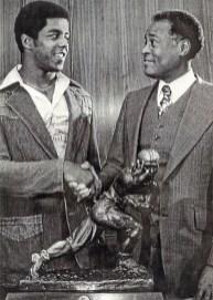 Herb Douglas Jr., right, congratulates Tony Dorsett, winner of the Heisman Trophy, 1976. (Courtesy of Heinz History Center)
