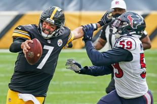Pittsburgh Steelers quarterback Ben Roethlisberger stiff arms Texans outside linebacker Whitney Mercilus, Sunday, Sept. 27, 2020, at Heinz Field on the North Shore. (Peter Diana/Post-Gazette)