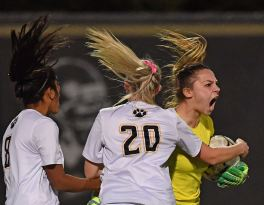 North Allegheny goalie Julianna Werner, right, celebrates after making a save against Butler on a goal kick during the AAAA WPIAL Soccer Championships, Thursday, Nov. 5, 2020, at Gateway High School in Monroeville. (Peter Diana/Post-Gazette)
