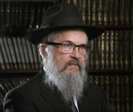 Rabbi Yisroel Rosenfeld of Pittsburgh's Lubavitch Center and Yeshiva schools poses for a portrait, Dec. 18. 2019, in the Lubavitch Center in Squirrel Hill. (Nate Guidry/Post-Gazette)