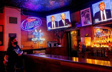 Bartender Krista Laurent, of Whitehall, watches the first presidential debate between President Donald Trump and former Vice President Joe Biden, Tuesday, Sept. 29, 2020, at Cupka's Cafe II in the South Side. The near chaotic debate deteriorated quickly as Trump interrupted and the two men frequently talked over each other. (Emily Matthews/Post-Gazette)