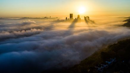 Downtown Pittsburgh is surrounded by fog as the sun rises, Thursday, Oct. 22, 2020. (Andrew Rush/Post-Gazette)