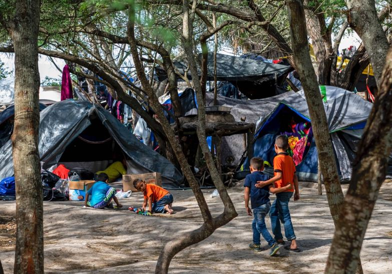 Children play in the migrant camp that sprouted on the southern side of the U.S.-Mexico border, Thursday, Jan. 17, 2020, in Matamoros, Mexico. Life in the makeshift camp presents security and health risks for children, with kidnapping, trafficking, and disease an ever-present concern. (Michael M. Santiago/Post-Gazette)