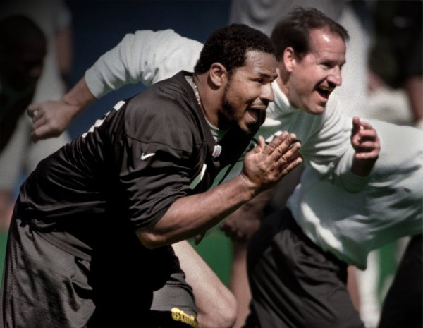 Jerome Bettis races Bill Cowher during practice June 4, 1997.