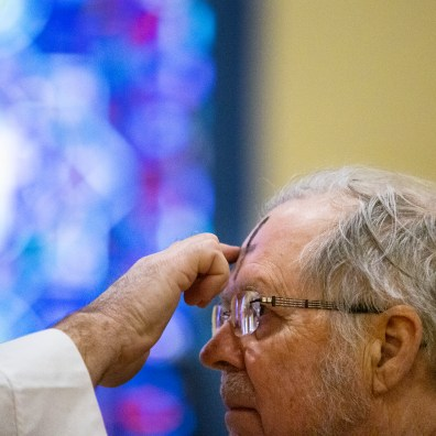 Pastor Peter Bowmer, left, offers ashes to Ken Schumaker during the Ash Wednesday service at St. Paul's Lutheran Church in Toledo, Ohio on Wednesday March 6, 2019. THE BLADE/REBECCA BENSON