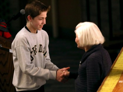 Perrysburg Junior High 8th grader Myles Takats (cq), 14, left, shakes hands with Irene Butter after she spoke to Perrysburg Junior High students at their school in Perrysburg, Ohio, on Wednesday, March 13, 2019. Butter is a Holocaust survivor, and was brought in to speak for part of the language arts curriculum, as the junior high students have been reading literature on the history of the Holocaust. Butter has written a book on her experiences in the Holocaust. THE BLADE/KURT STEISS CTY Holocaust14