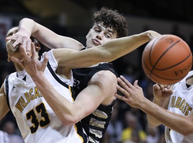 Sylvania Northview's Sean Craig (33), left, battles Perrysburg's Jackson Sizemore (33) for a rebound during a Division I boys district semifinal basketball game Thursday, March 7, 2019, at Savage Arena in Toledo, Ohio. THE BLADE/JEREMY WADSWORTH