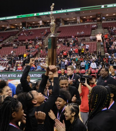 Rogers' Zia Cooke hoists the girls Division II State Championship Trophy after defeating Dayton Carroll, 56-45, Saturday, March 16, 2019, at the Jerome Schottenstein Center in Columbus, Ohio.THE BLADE/JEREMY WADSWORTH SPT D2stateGBK17