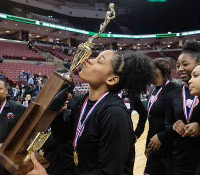Rogers' Zia Cooke kisses the girls Division II State Championship Trophy after defeating Dayton Carroll, 56-45, Saturday, March 16, 2019, at the Jerome Schottenstein Center in Columbus, Ohio.THE BLADE/JEREMY WADSWORTH SPT D2stateGBK17
