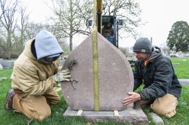 Jim Wires, left, and Jerry Knott guide a headstone onto its base at Riverside Cemetery in Maumee, Ohio on Wednesday April 17, 2019. Riverside Cemetery was damaged from flooding and ice from the Maumee River in February. THE BLADE/REBECCA BENSON CTY cemeterycleanup