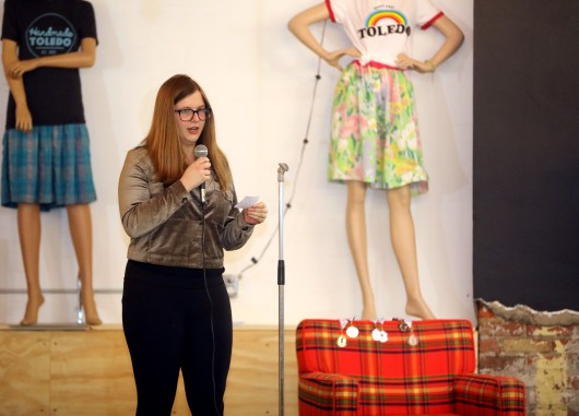 Avery Thompson recites her poem for ZIP Code 43551 (Wood County) during the Ode to the ZIP Code live event at Handmade Toledo in Toledo on Thursday, April 18, 2019. Toledo area residents participating read their short poems inspired by their ZIP Code, where the number of words in each line of the poem is determined by the corresponding digit in their ZIP Code. THE BLADE/KURT STEISS CTY poetry18p